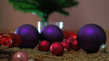 Christmas colorful balls, Plastic Snowflakes on floor. Mans Hand Decorating Christmas Three.