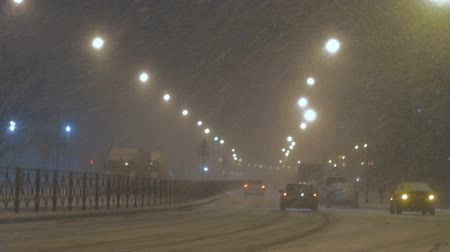 Strong night snowfall in city