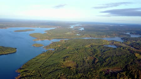 marine park : aerial view over the finnish archipelago full of islands. Aerial footage of a woodland and sea at Aland Islands