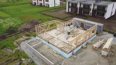 inacabado : Aerial view of building timber frame house Stock Footage