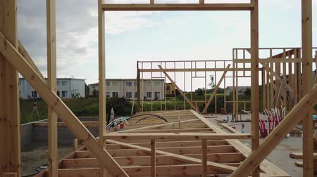 truss : Aerial view of building timber frame house Stock Footage