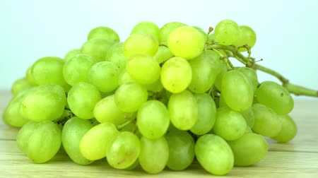 szőlőművelés : green grape rotating closeup slow motion 4k, isolated on white