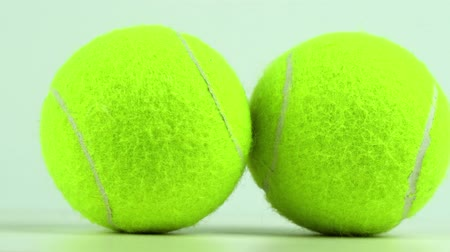 rotational : rotating two tennis balls, closeup, slow motion 4K video