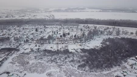 szibéria : Beautiful winter landscape. Siberian village in the cold. Sunrise. Industrial landscape.