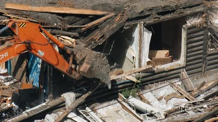 demolition : Demolition of an old house. An excavator clears a place for the construction of a new house. Demolition of dilapidated housing.