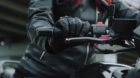 deneme : Close-up of the Motorcyclists Hand. The concept of speed, movement, breakthrough, acceleration. A female hand in a leather glove turns the throttle on a motorcycle.