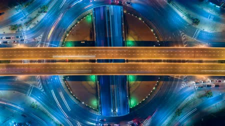 way out : Hyperlapse timelapse of night city traffic on 4-way stop street intersection circle roundabout in bangkok, thailand.