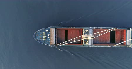 visão global : Aerial shot top view container ship crane on container running have wave in ocean.