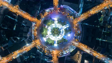 yaymak : aerial top view traffic circle road roundabout multi 6 lanes in bangkok city at night, Time lapse top road in thailand, zoom out.