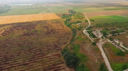 obec : Aerial panoramic shot of agricultural fields and settlement with roads and greenery. at dull day. The shot was captured in Crimea.