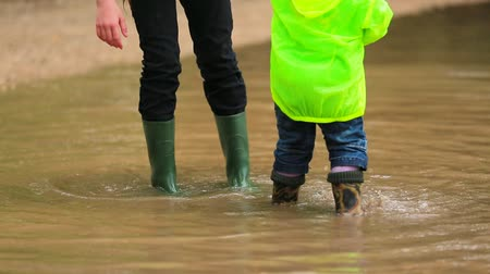 bota : Happy Children Jumping In Huge Puddle