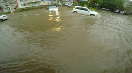 floods : Slow Car Traffic In Deep Waters In City Road