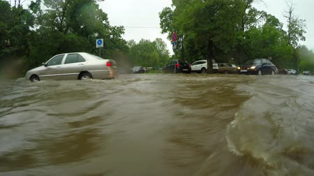floods : Cars Struggle To Proceed In Flooded Road