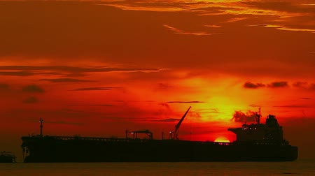 time laps : Cargo ship at sunset yellow sky