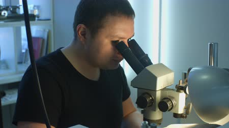 appraising : Jeweler looking at the dimond ring through glasses Stock Footage