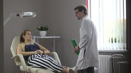 Woman at consultation with her doctor.