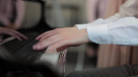 Musicians hands playing the piano