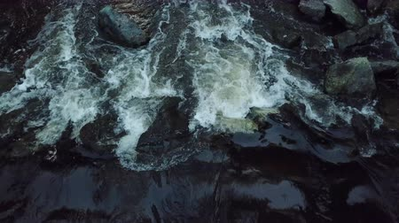 стремнина : Water flow of a river captured by the flying dron