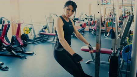 Beautiful sporty brunette Woman middle aged working out doing squats.