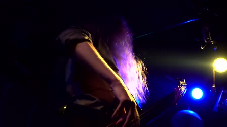 Concert rock performing, guitarists and soloist. Music video punk, heavy metal or rock group.. Close up man guitarist playing rock music on strings and dancing at performance. slow-motion Dostupné videozáznamy