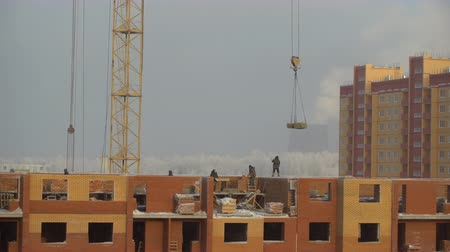 Workers building a new house. Industry construction and development. Construction Site. construction crane.