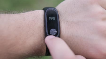 pedometer : Fitness bracelet on the arm. Check heart beats on fitness bracelet