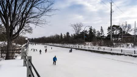 skate : OTTAWA, ONTARIO  CANADA - JANUARY 20  2018: PEOPLE SKATING ON RIDEAU CANAL. 4K TIMELAPSE VIDEO.
