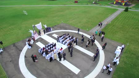 heliport : Aerial shot of Wedding ceremony on the helicopter platform on April 19, 2016 in Truskavez, Ukraine