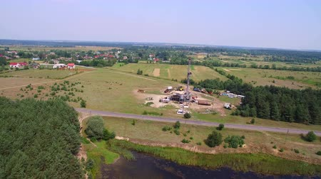 energetyka : Aerial view of the oil gas drilling tower in forest
