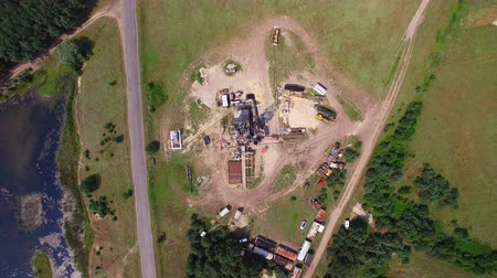 energetyka : Aerial top view of the oil gas drilling tower in forest