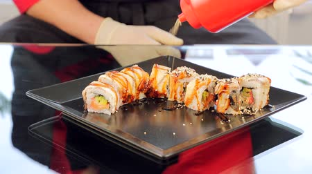 cutting mat : Closeup of chef sushi sprinkle with sesame seeds. Cooking Sushi Stock Footage