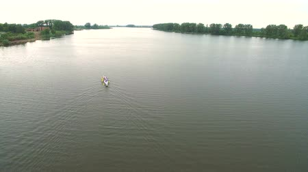 регата : Rowing and Canoeing. The view from the drone on the river swimming athletes Aerial