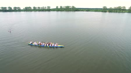 regaty : Rowing and Canoeing. The view from the drone on the river swimming athletes Aerial