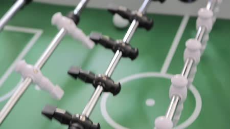 eğlence oyunları : Close-up Game of table football. Dynamic movement of players and cameras during the game Stok Video