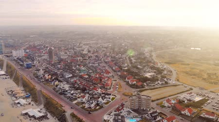 duna : Quadcopter flight over the Zandvoort beach in the Netherlands. Morning sunrise over the city