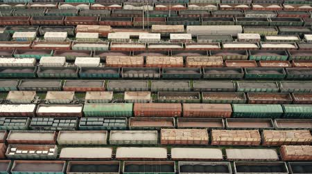 storage tank : Aerial Flight over freight wagons. Colored freight wagons at the unloading and loading freight wagon station. Logistics