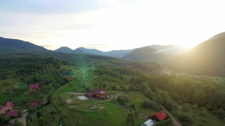 horská pastvina : Aerial Drone Footage View. Sunset in the mountains. Scenic landscape of mountain ranges at sunset Dostupné videozáznamy