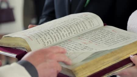 poezja : Priest turns the Bible page on a close-up in the church during the ceremony
