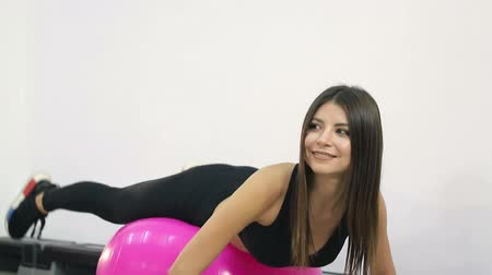 bodyweight : Cute girl performs fitness exercises on the ball. Healthy lifestyle in the gym