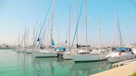 kotva : Yacht club Wonderful morning in the valence port. Yachts parked are rocking on waves. Sailboats are parked by the Sea Port