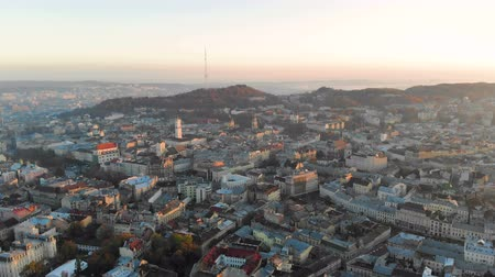 lviv : Flight over the central part of the city of Lviv in Ukraine. Morning sunrise over the city. Beautiful panorama of the morning city.