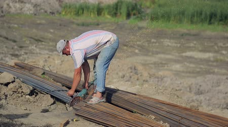 арматура : Ukraine. Lviv. 19 September 2018: Construction workers hammer on the foundation for a massive construction project. The region is developing at a rapid pace.