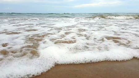 litoral : SLOW MOTION, CLOSE UP The wave moves toward the shore, moving towards the beach. Drops of the wave are throbbing uphill. Slow motion of the sea wave near the shore Stock Footage