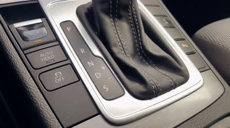 gearstick : The mans hand in close-up switches the transmission of an automatic gearbox. Parking, drive, reverse.