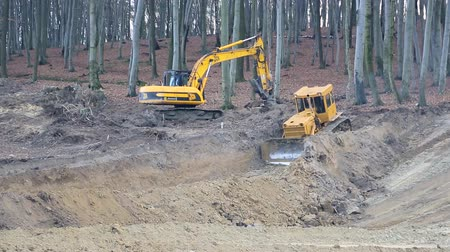 backhoe loader : UKRAINE LVIV December 29th 2018. Work of excavators and bulldozers on the construction site. Ground alignment Stock Footage