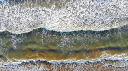 zátoka : Aerial view of the beach of spain The waves come to the shore and form foam and bubbles off the coast. The look of a dron. Background or Texture Dostupné videozáznamy