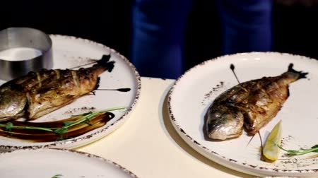 morina : Dorado fish on a plate. Chefs signature dish on a plate with lemon and herbs Stok Video