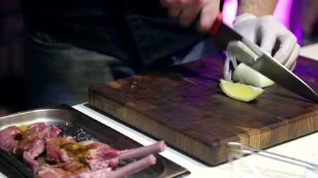 picado : cook the white onion slices in the cosy restaurant with dim lighting