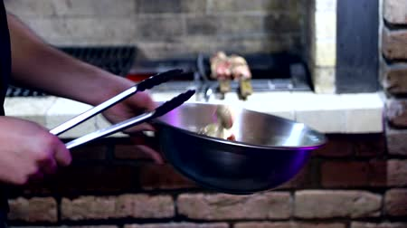 picado : the chef mixes the salad in a metal bowl tossing it in slow motion