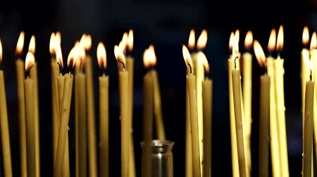 canon : Yellow candles that burn in the Church. Background